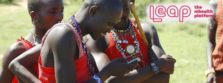 Masai people looking at a mobile phone